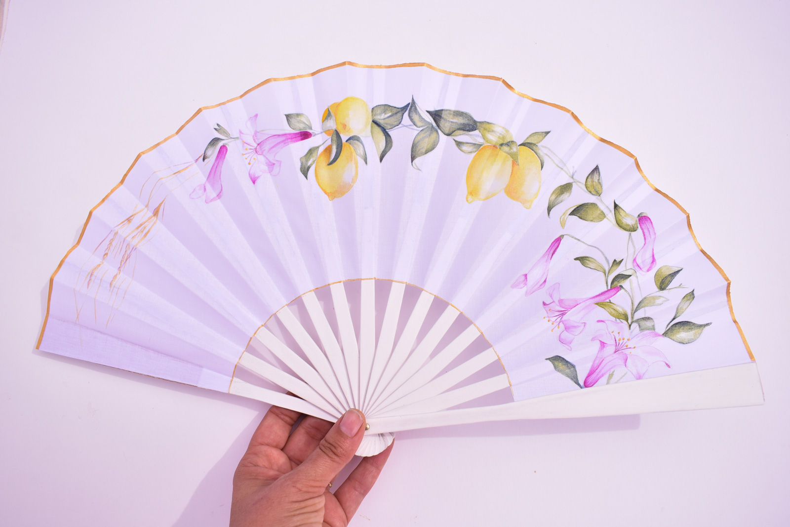 hand-fan-lemons-and-flowers